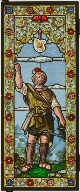 Wilhelm Tell ist stehend mit Armbrust und hochgehaltenem Pfeil vor einer Landschaft mit dem Urnersee und den hohen Bergen dargestellt. Über seinem Haupt hängt sein Wappen mit dem durchschossenen Apfel. Bildfenster, Karl Wehrli (1843–1902), um 1880, farbige Gläser, bemalt © Schweizerisches Nationalmuseum