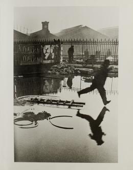(C) Henri Cartier-Bresson. Behind the Gare Saint-Lazare. Silver-gelatine print, 1932.